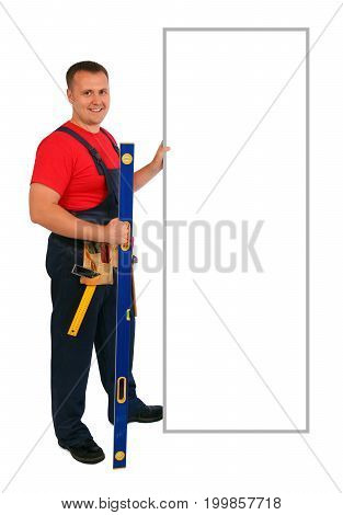Full length portrait of an happy caucasian construction worker pointing something on an blank billboard. Smiling handsome plumber. Handyman isolated on white background