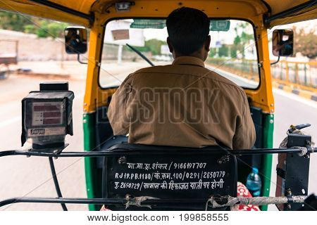 JODHPUR RAJASTHAN INDIA - MARCH 04 2016: Wide angle picture from the back of a tuk tuk driver at Jodhpur the blue city of Rajasthan in India.