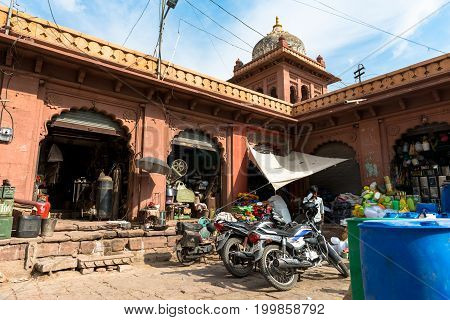 JODHPUR RAJASTHAN INDIA - MARCH 04 2016: Horizontal picture of motorcycle workshop in Jodhpur the blue city of Rajasthan in India.