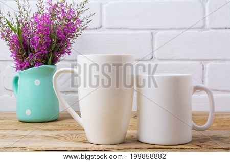 Two White Coffee And Cappuccino Mug Mockup With Maroon Purple Flowers In Mint Pitcher