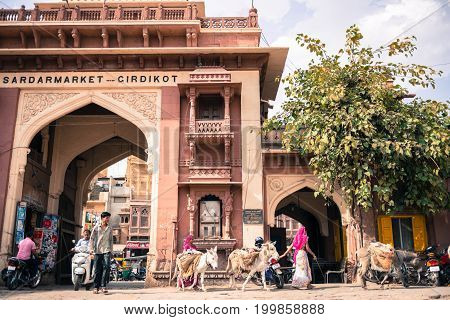 JODHPUR RAJASTHAN INDIA - MARCH 04 2016: Wide angle picture of native people and Girdikot Gate in Jodhpur the blue city of Rajasthan in India.