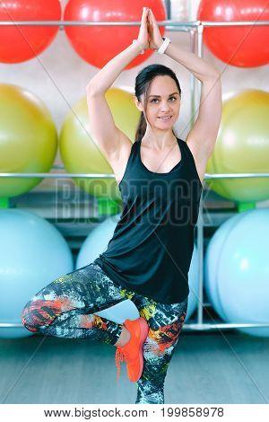 portrait of sport girl doing yoga stretching yoga exercise