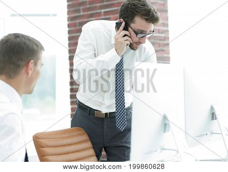 angry businessman talking on smartphone