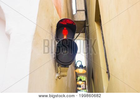 Narrowest street with traffic light in Prague city.