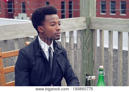 young man waiting and drinking bored restaurant dating alone wine bottle
