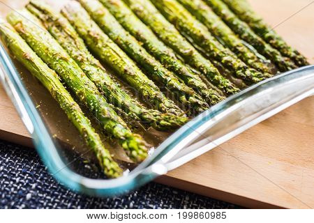 Cooked green asparagus on a plate in the kitchen