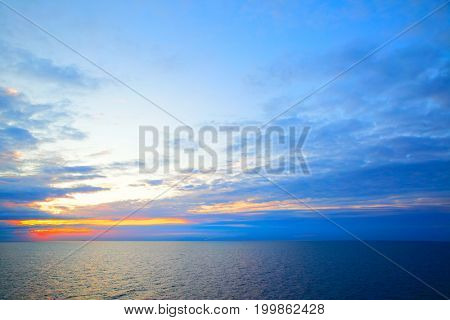 Beautiful sundown in Sweden flag colors - seascape with sea horizon, may be used as background.