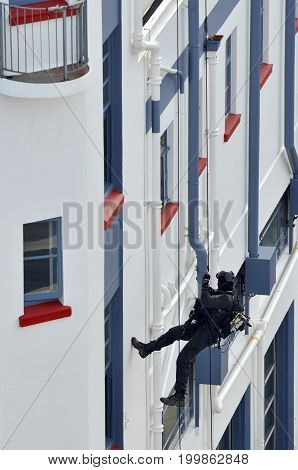 Counter-terrorism Police Officer Abseiling A Building