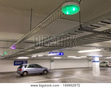 Car Parking lot sensors on ceiling Indicator Light show Parking space unoccupied is green