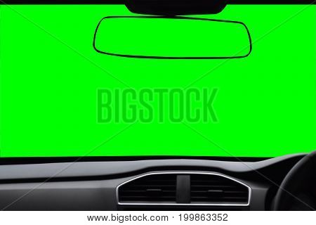 Windshield and rearview mirror View inside the car with green scree Isolated on background with clipping path