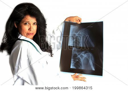 Hispanic Woman Doctor with X-Ray. A beautiful Latino Doctor or Nurse with X Rays. Isolated on white. Room for text.