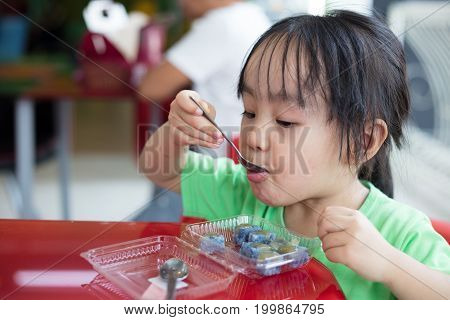 Asian Little Chinese Girl Eating Glutinous Rice