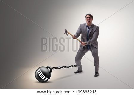 Debt concept with businessman escaping loan burden with axe