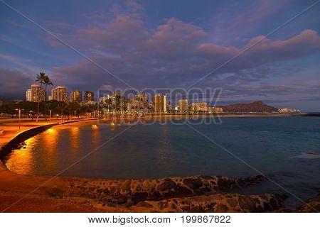 Honolulu panorama at night Hawaii USA. Waikiki beach after sunset on Oahu.