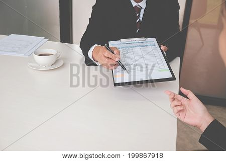 Interview  about to sign a legal document which would be a binding mutual agreement