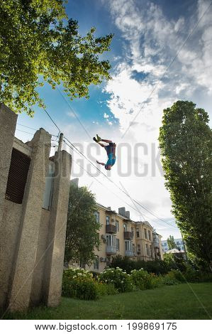 City parkour. The guy does the opposite somersault. Shooting from a low angle. Agility adrenaline and extreme.