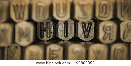 HIV spelled from metal stamp alphabet punch HIV words stand for The Human Immunodeficiency Virus