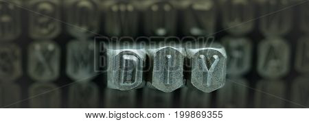 DIY spelled from metal stamp alphabet punch DIY words stand for Do It Yourself concept