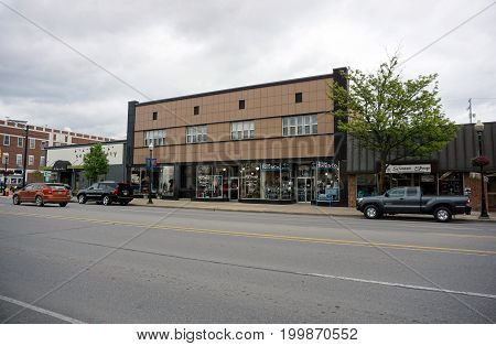 CADILLAC, MICHIGAN / UNITED STATES - MAY 31, 2017:  One may buy home decor at Country Cottage Decor and Gifts, clothes at RJ Grants of Cadillac, and gifts at the Blue Bench Company, on Mitchell Street in Downtown Cadillac.
