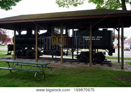 CADILLAC, MICHIGAN / UNITED STATES - MAY 31, 2017:  An antique Shay locomotive is on display in the Cadillac Commons City Park.
