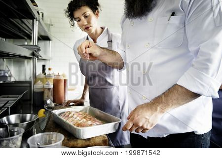 Chef making a meat marinated