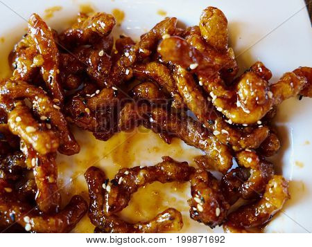 Traditional Chinese glazed pork in sweet sour sauce served in a restaurant