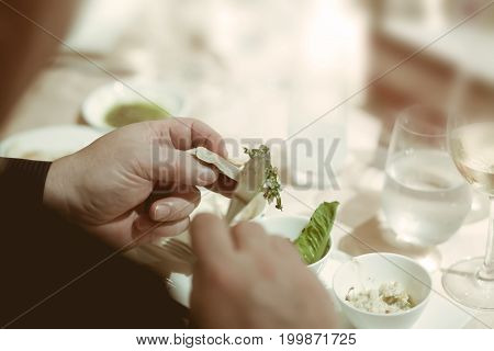 Gourmet Eating And Tasting Food In Luxury Dinner Party, Blurry Background With Vintage Color Style.