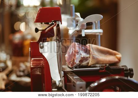 Meat Slicer Machine On The Table In Luxury Dinner Party, Blurry Background With Vintage Color Style.