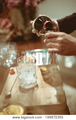 Bartender Pour Cocktails  Ingredients  Into Measuring Cup For Making Cocktail In Luxury Dinner Party