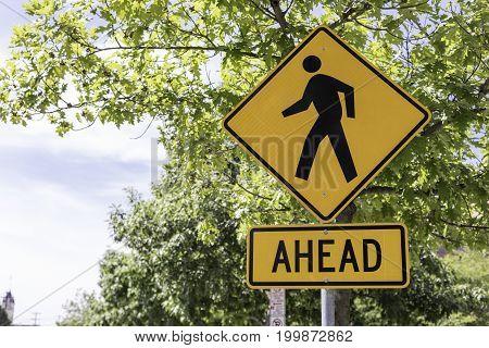 Pedestrian crossing sign in an urban setting