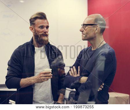 Men colleagues coffee break talking together