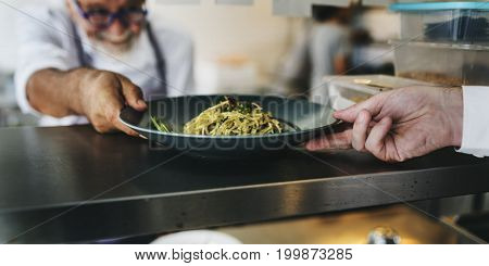 Chef push a food tray to a shelf