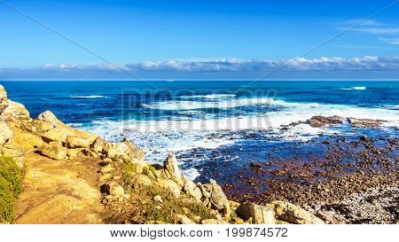 Waves rolling on to the shoreline of the Atlantic Ocean coast at Cape of Good Hope in Cape Point Nature Reserve on the Cape Peninsula in South Africa