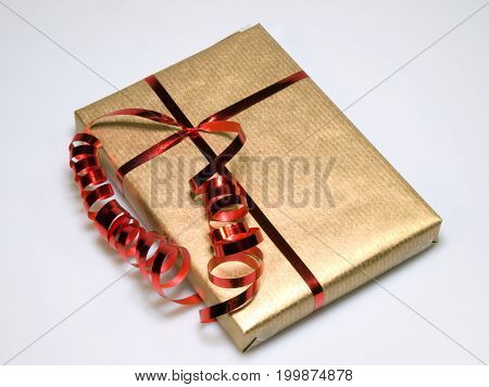 Present wrapped in gold and red with bow