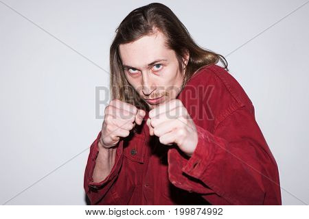 Angry fighting man. Sorting out relationships. Adult evil boxer, furious male battling with someone, aggression concept