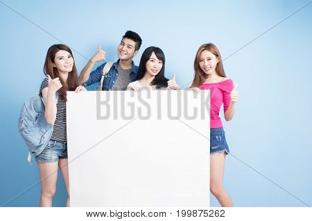 happy group student take billboard and shoe thumb up on the blue background