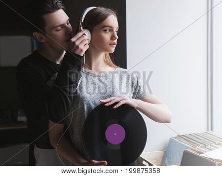 Girl listening good music. Seduction background. Man distracting confident woman, love relationship. Independence style