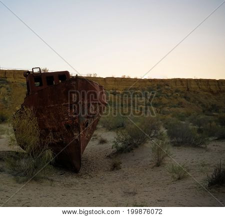 ship cemetery at sunset near Moynaq at Karakalpakstan Uzbekistan