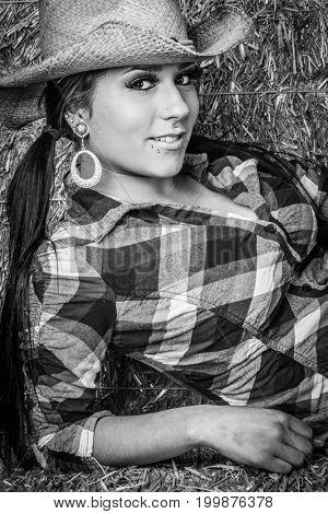 Beautiful smiling cowgirl wearing hat