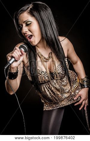 Pop star girl singing with microphone