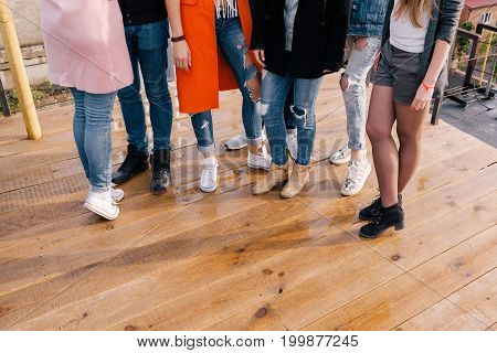 Women company. Fashion style background, unrecognizable females. Girls party, friendship concept