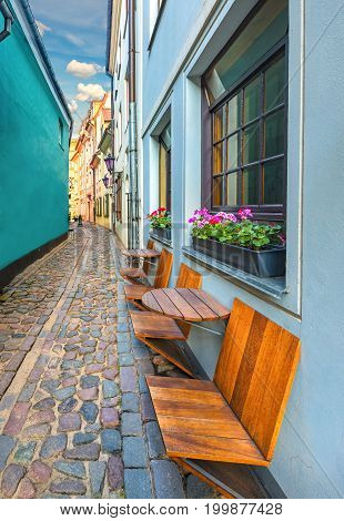 Narrow medieval street in old Riga - capital city of Latvia and famous place of ancient and medieval architecture in Baltic region