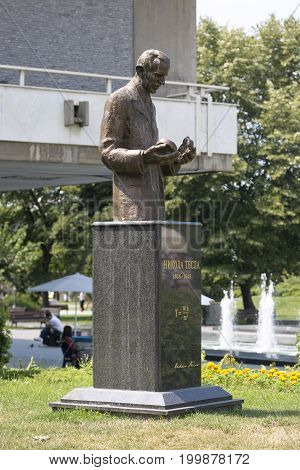 BELGRADE, SERBIA - JULY 31, 2017:Monument to Nicolas Tesla in Belgrade near the building of the National Library of Serbia