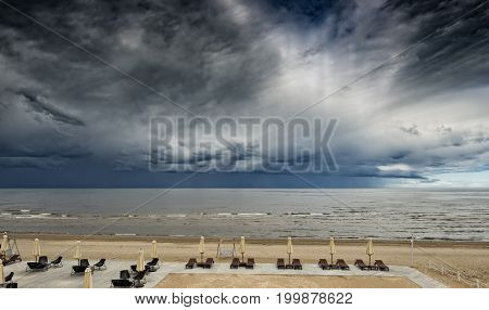Approaching thunderstorm at sandy beach of the Baltic Sea, Europe. Image toned for inspiration of mystical visual perception