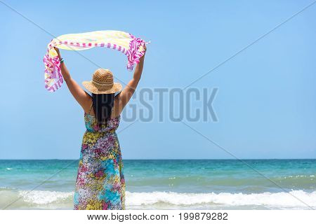 Happy woman on the beach in summer.