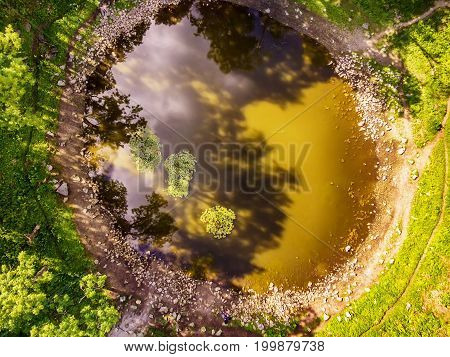 Saarema Island, Estonia: aerial top view the main meteorite crater in the village of Kaali in the summer