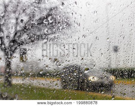 Bad Weather Driving - poor view caused by heavy rain and spray water