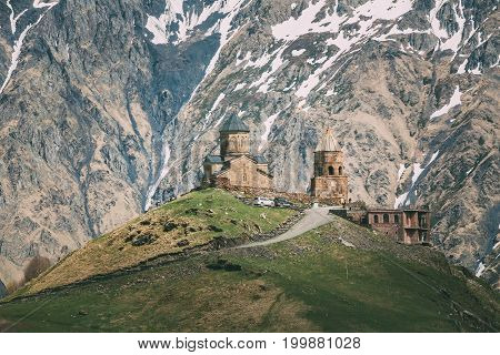 Stepantsminda, Gergeti, Gergia. Trinity Church Or Tsminda Sameba - Holy Trinity Church Near Village Of Gergeti. Church Is Situated At An Elevation Of 2170 Meters, Under Mount Kazbegi. Spring