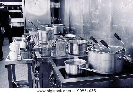 Typical kitchen of a restaurant in operation, toned image