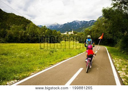 Tandem of father and daughter, family cycling in Alpe Adria itinerary - Friuli-Venezia Giulia, Italy